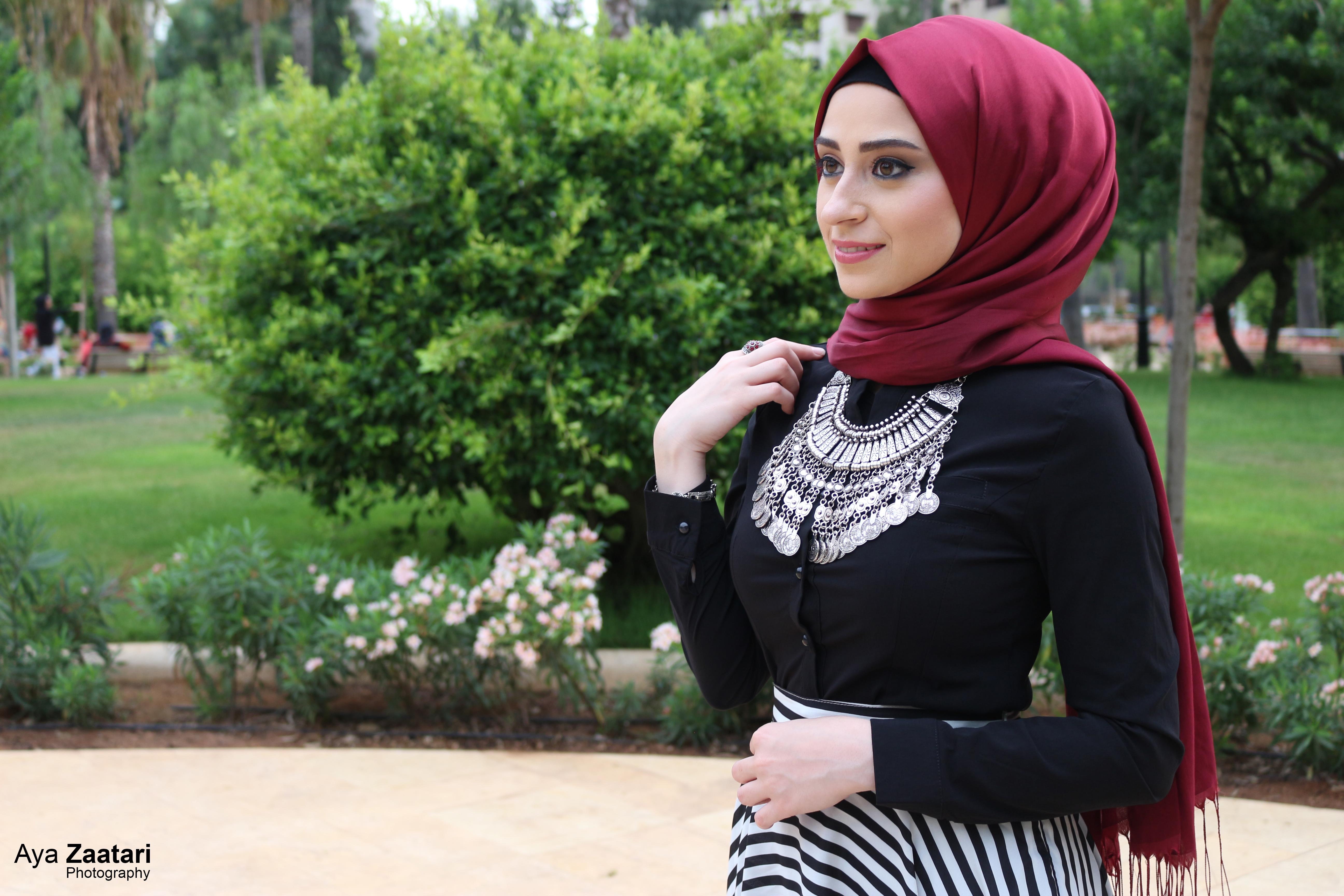 Modern girl hijab and black and white skirt